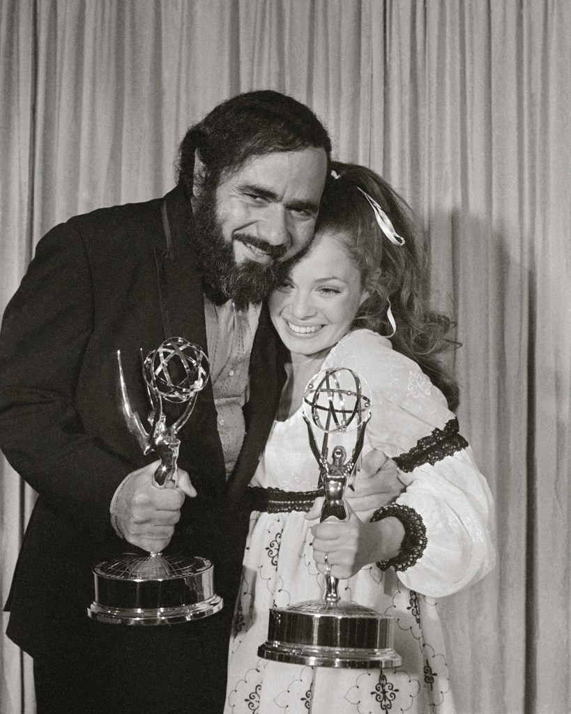 """Actress Karen Valentine holding her Emmy for Best Supporting Performance by an Actress in a Comedy series, and actor Michael Constantine with his Emmy for Best Supporting Actor in a Comedy series. Both actors won for the TV series """"Room 222""""."""