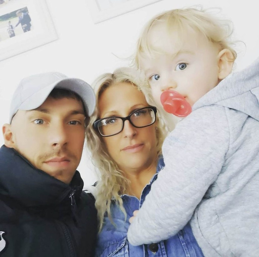 """Dan and Kate Harman with their """"miracle"""" baby, Buddy."""