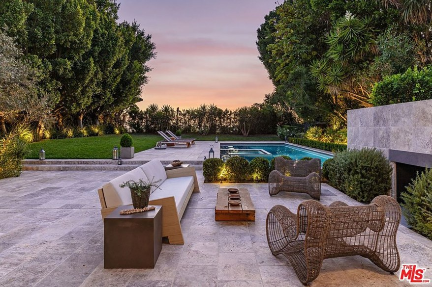 The 0.36-acre lot has a pool, a hot tub, a lounge and a lawn.
