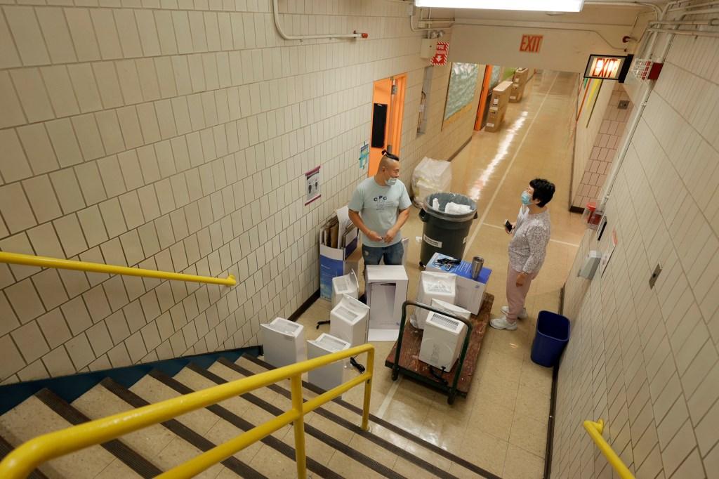 Staff prepare school hallways for students in NYC.