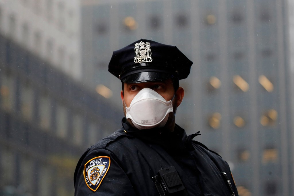 A New York Police officer wears a mask to protect against coronavirus.