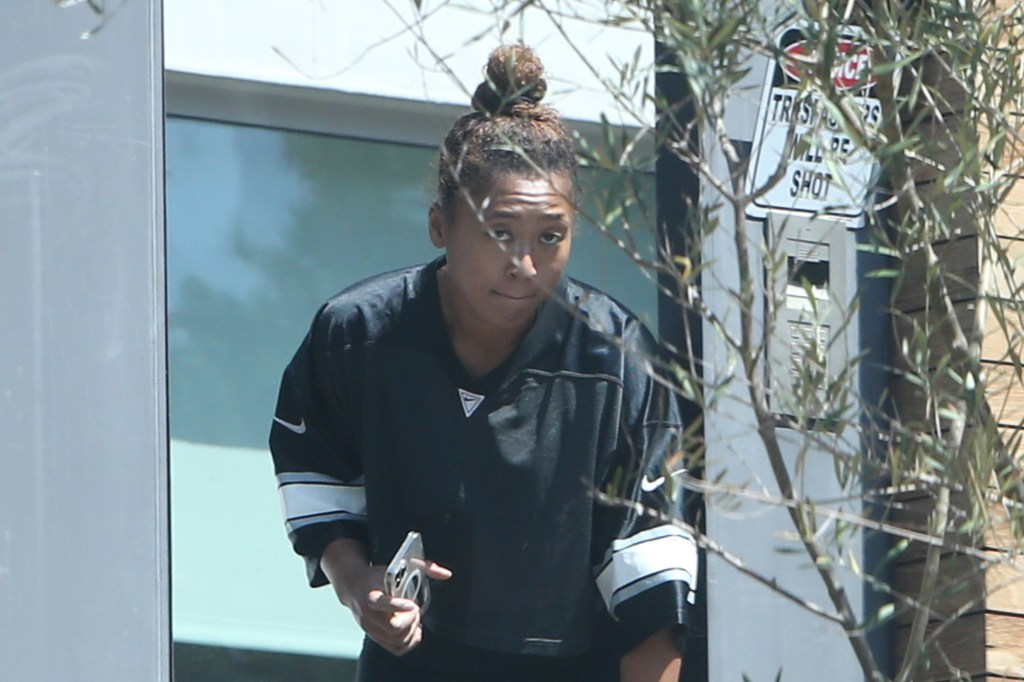 The 23-year-old champion looked somber as she grabbed a food delivery outside her $7 million Beverly Hills mansion on the Labor Day holiday