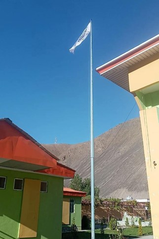 A view of a flagpole with the Taliban flag outside the provincial governor's office, symbolizing their victory.