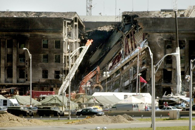 Workers remove debris at the Pentagon on September 15, 2001.