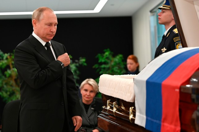Russian President Vladimir Putin passes by during the farewell ceremony of Russian Emergency Situations Minister Evgeny Zhenyev.