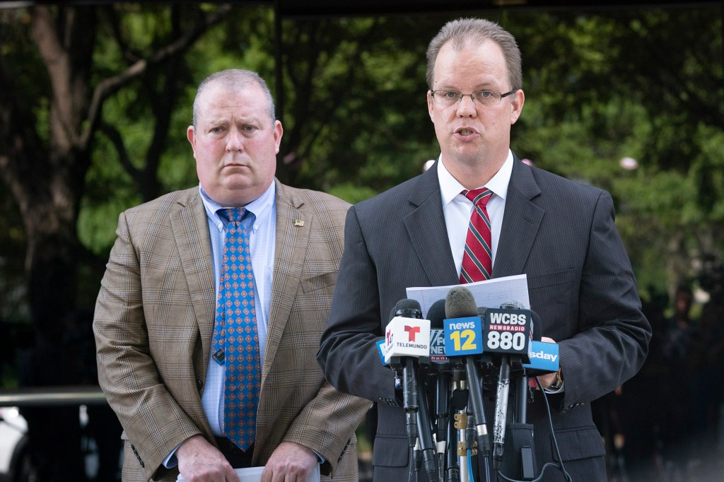 BOHEMIA, NY September 13, 2021 R-L: Rich Stafford along with Christopher Brocato read a statement from the Petito, Schmidt, family about missing 22 year old Gabby Petito,.