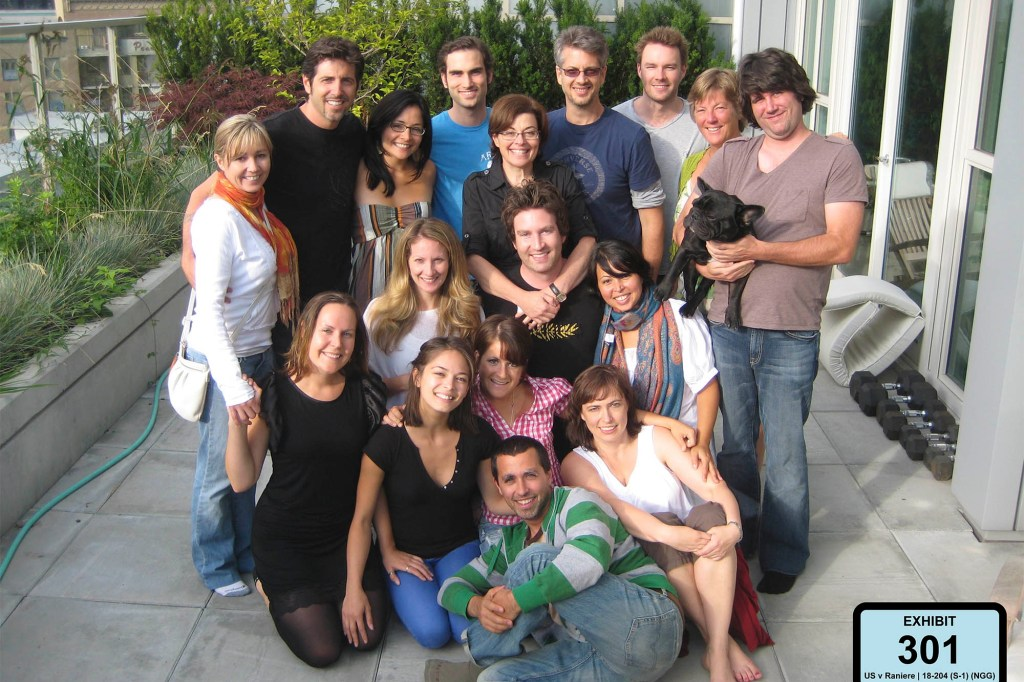 A photo released into evidence Wednesday, May 15, 2019, during the NXIVM Keith Raniere trial.  Members of the Vancouver Center. The woman in the second row on the left in the black v-neck is Kristin Kruek. The two women with the glasses (left to right) are Sarah Edmondson and Nancy Salzman. Vicente is in the back with the glasses.