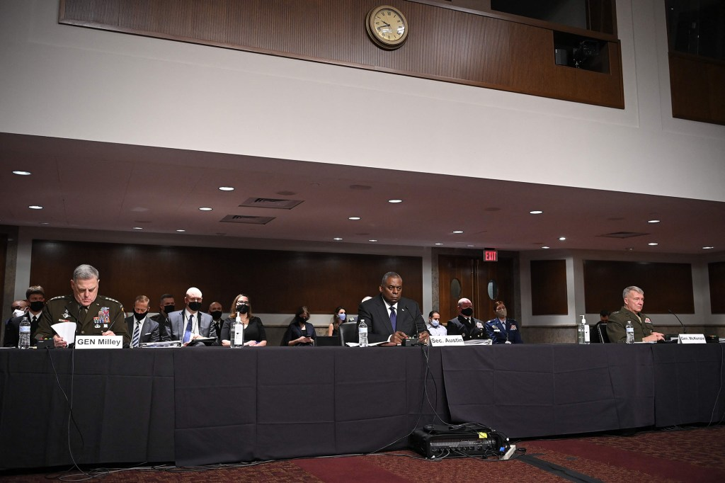 Defense Secretary Lloyd Austin(C), Chairman of the Joint Chiefs of Staff Gen. Mark Milley(L), and Commander of US Central and Command Gen. Kenneth McKenzie(R) testify.