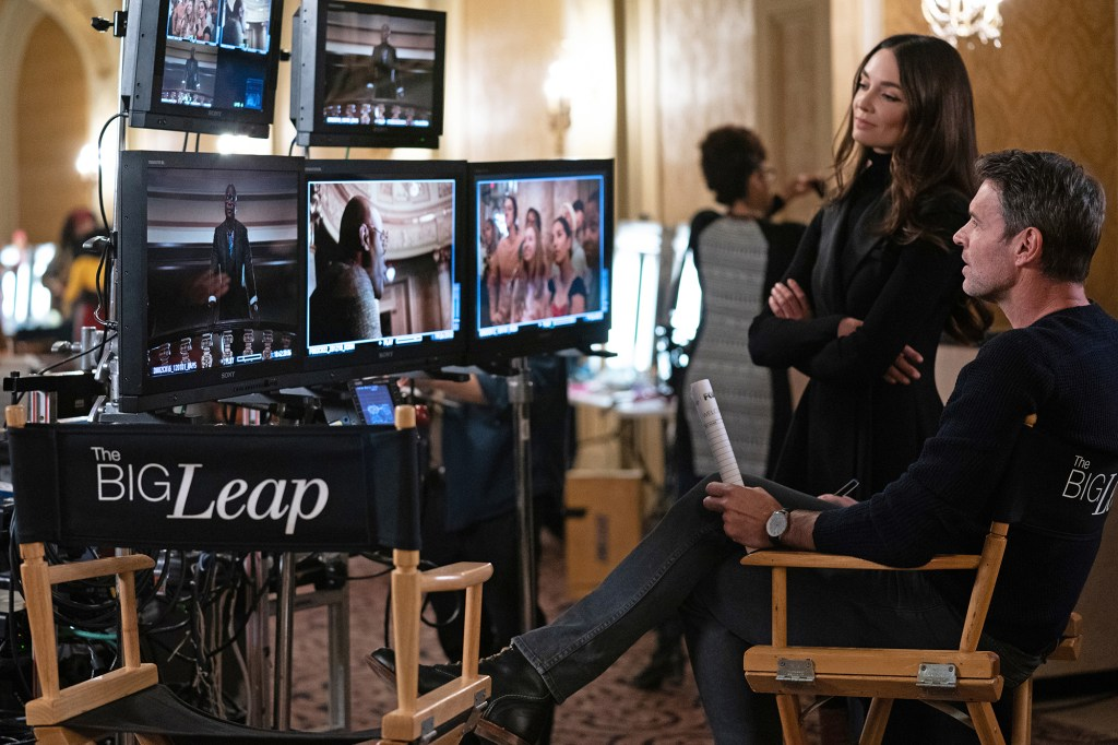 """Scott Foley as Nick and Mallory Jansen (left) as Monica look at video monitors in """"The Big Leap"""