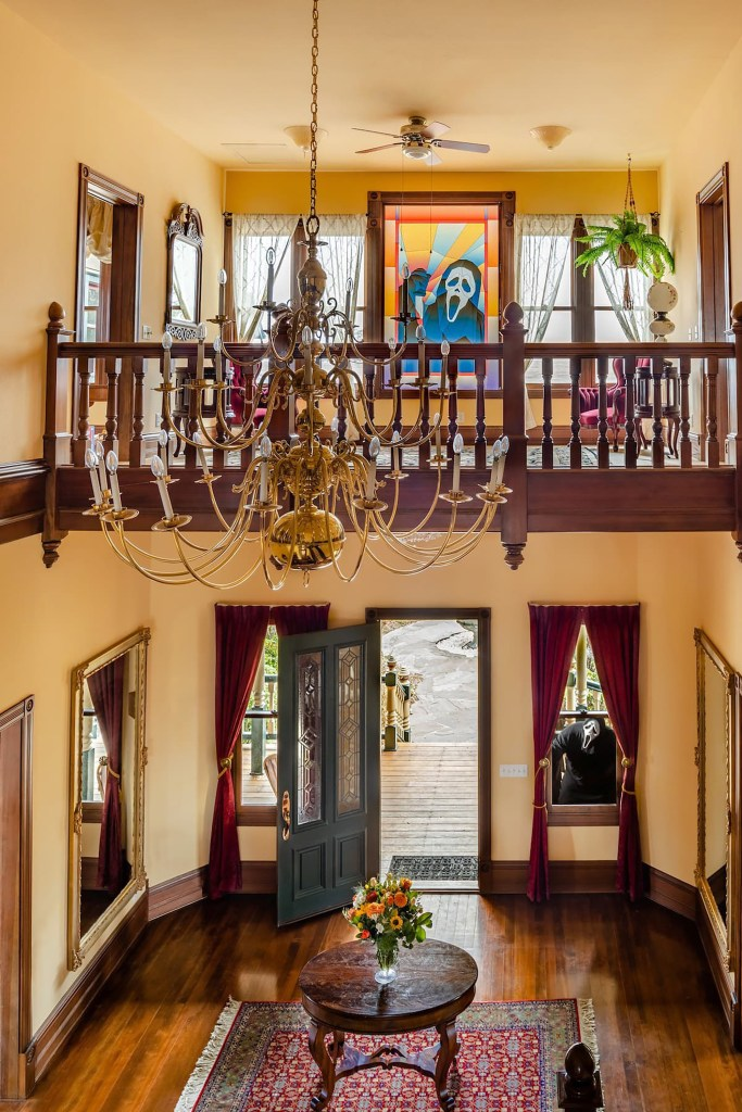 As guests approach the 4,900-square-foot mansion, a Ghostface stained glass window sets the scene.
