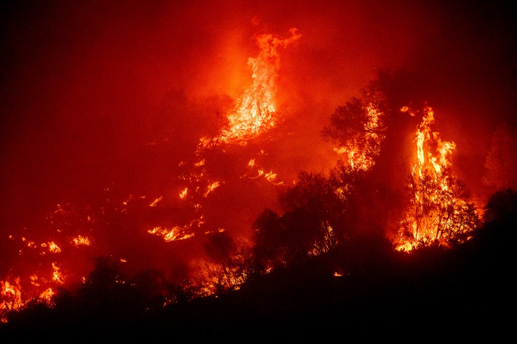 Flames from the KNP Complex Fire burn a hillside above the Kaweah River in Sequoia National Park, Calif.