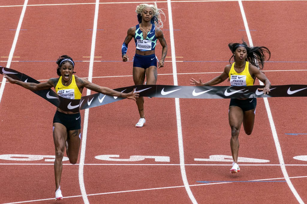 Jamaica's Elaine Thompson-Herah, left, wins the 100 meters, as American track and field sprinter Sha'carri Richardson, center, also competes at the Prefontaine Classic.