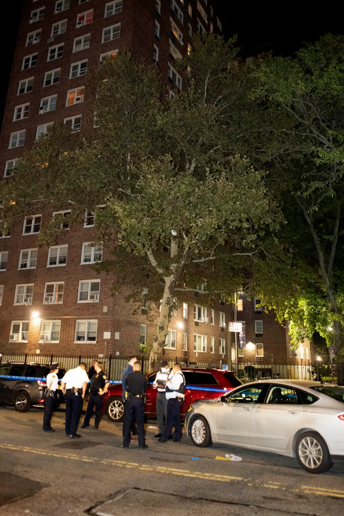 Police are seen at the scene of a shooting at 50 W 139 St. in Manhattan.