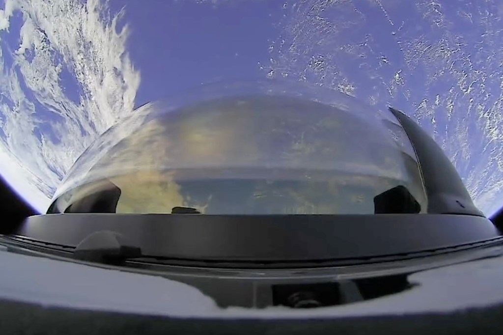 An outside view from the Dragon's cupola as the SpaceX Falcon 9 rocket breaches the top level of the atmosphere.