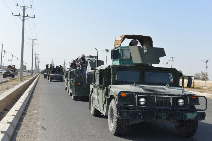 The Taliban continued their victory celebrations with a military parade as fighters wave white Taliban flags from Humvees and armored SUVs