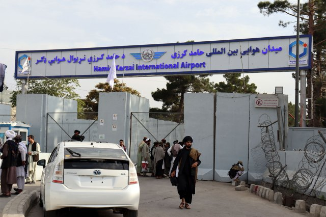Taliban guards in front of Hamid Karzai International Airport in Kabul on August 31, 2021.