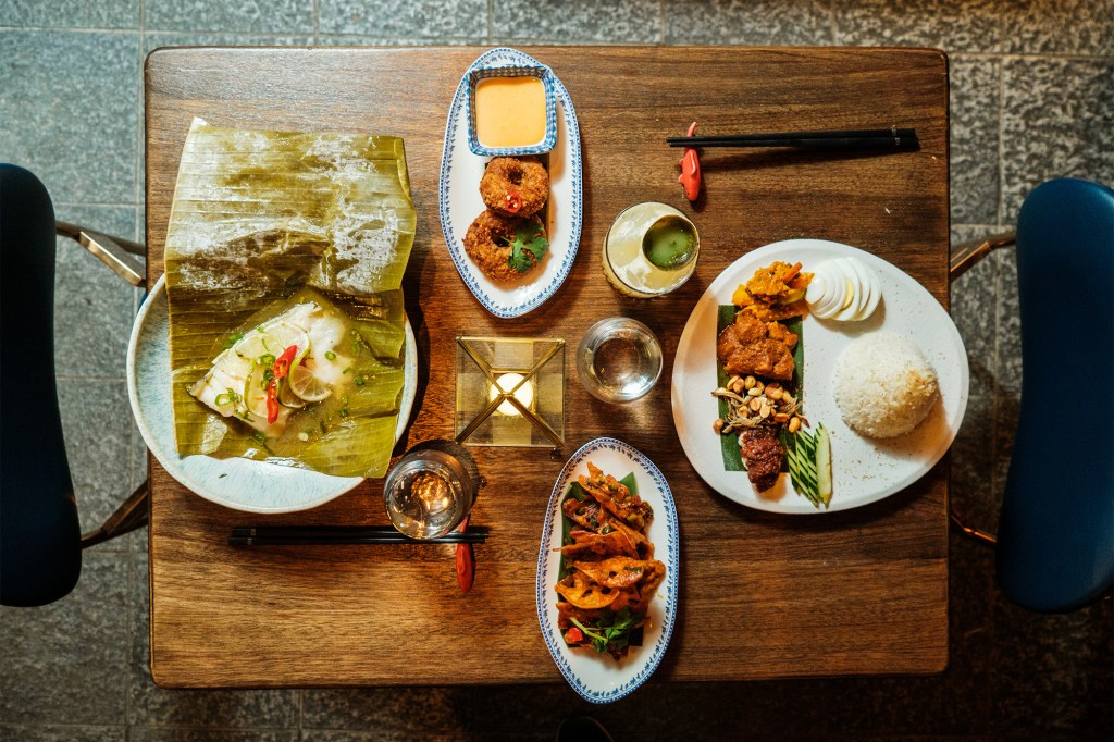 New UWS Southeast Asian spot Wau serves up savory donuts (clockwise from top), Nasi Lemak, Crispy Lotus Root and Sea Bass.