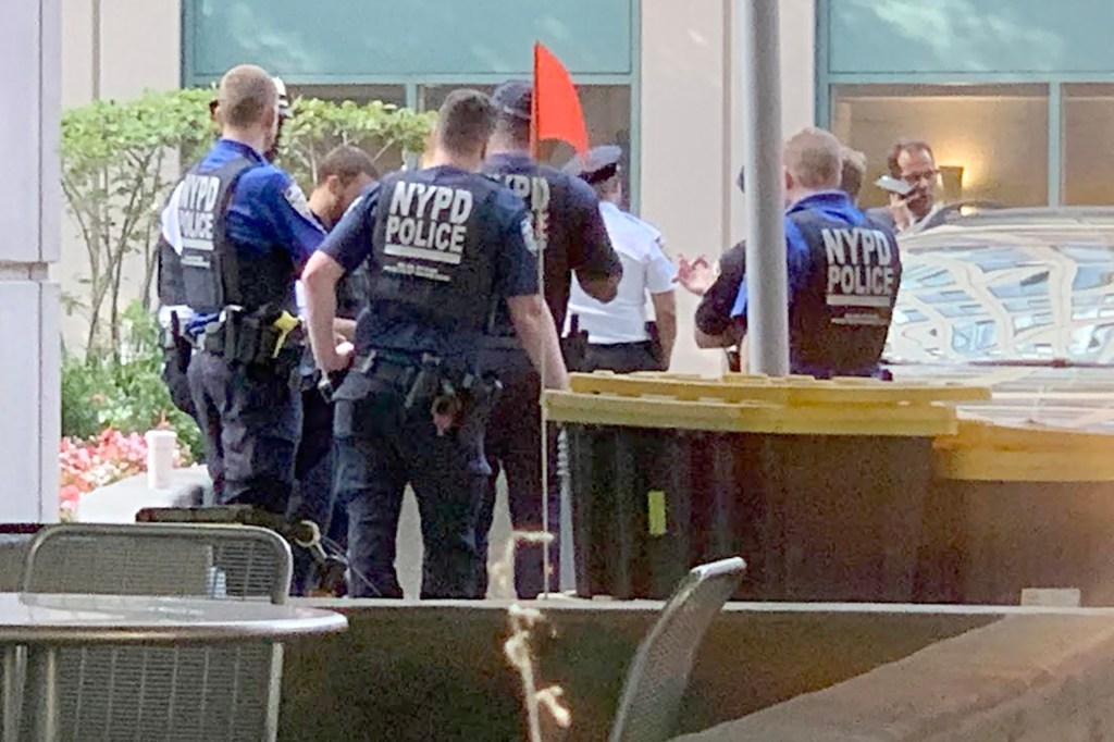 Cops outside the penthouse.
