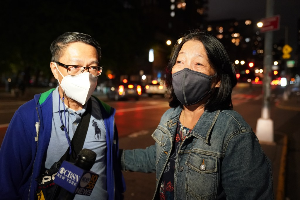 Irineo Ambrocio and Emilia Cruz, speaking to the media about Maria Ambrocio outside of Bellevue Hospital in New York, NY on October 9, 2021.
