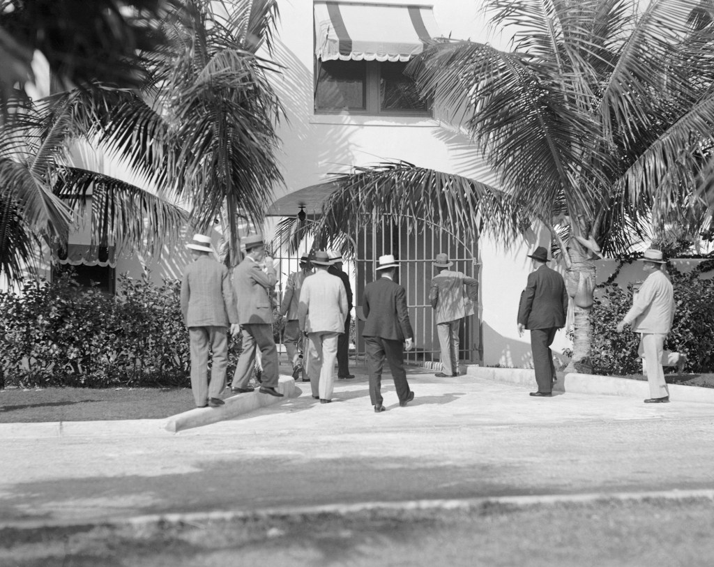 Photo shows men from the Sheriff's Department of Dade County, entering Al Capone's home at Miami Beach, Florida, for a raid.
