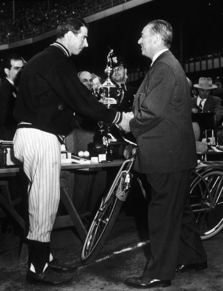 New York Yankee Joe DiMaggio shakes hands with New York City Mayor William O'Dwyer in a pre-game ceremony at Yankee Stadium.