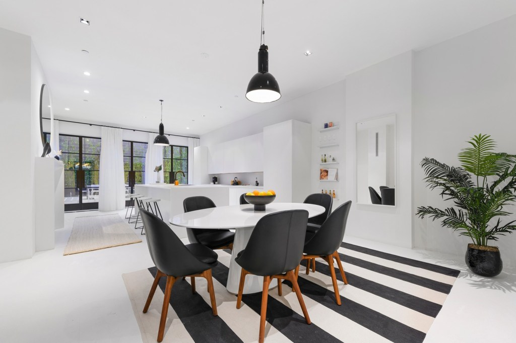 The black-and-white dining and kitchen area inside the townhouse.