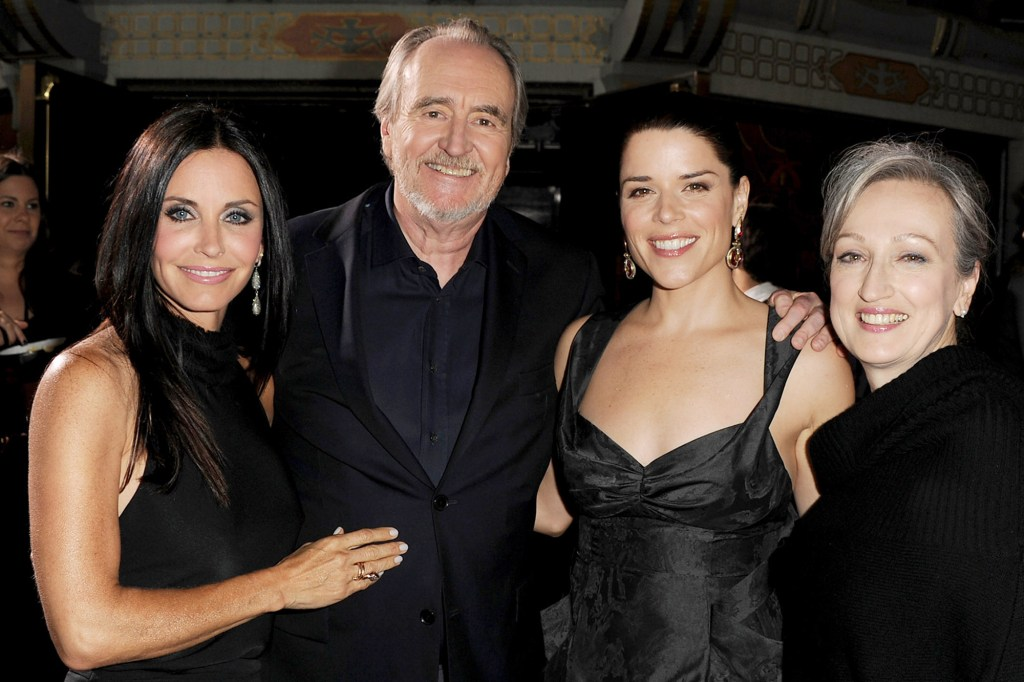 """""""Scream 4"""" stars Courteney Cox and Neve Campbell join Craven at the film's premiere in 2011."""