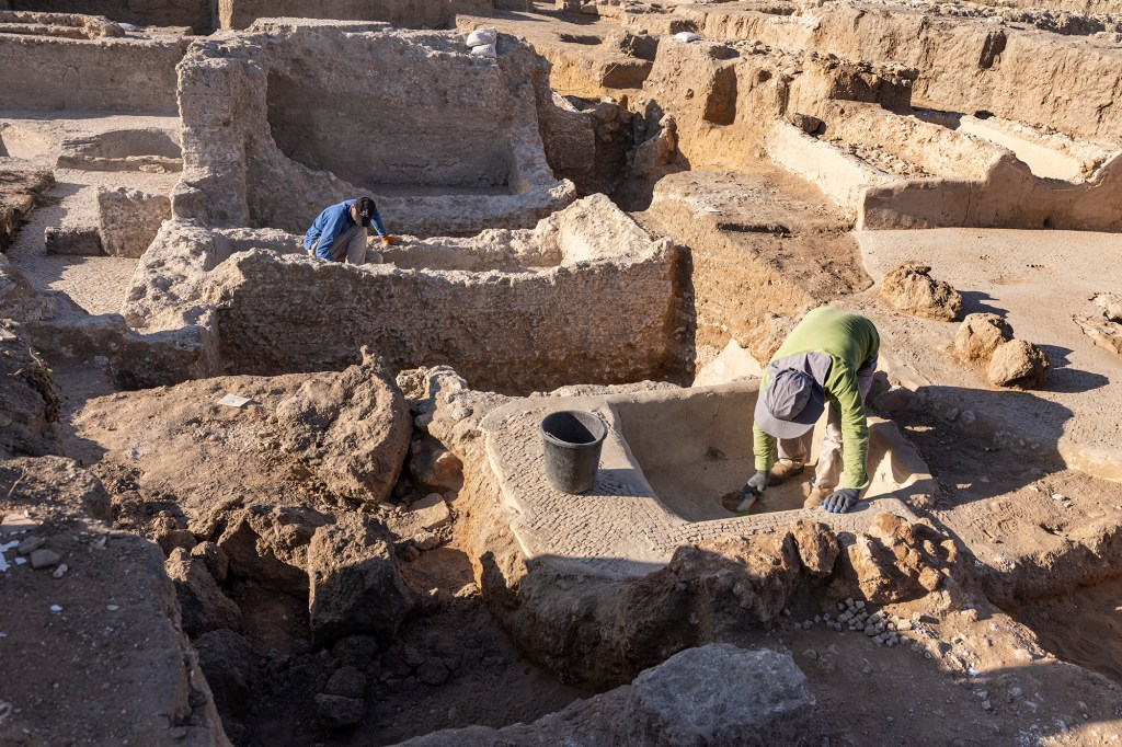 Israel Antiquities Authority employees work in a massive ancient winemaking complex dating back some 1,500 years in Yavne, central, Israel, Monday, Oct. 11, 2021.
