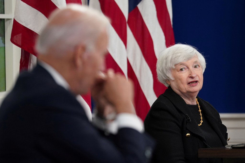Treasury Secretary Janet Yellen speaks with President Joe Biden during a meeting on the federal debt ceiling at the White House on October 6, 2021.