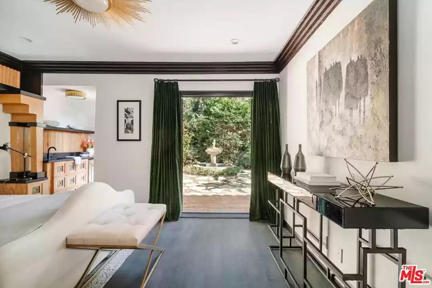 The bedroom has a sun-like ceiling light fixture.