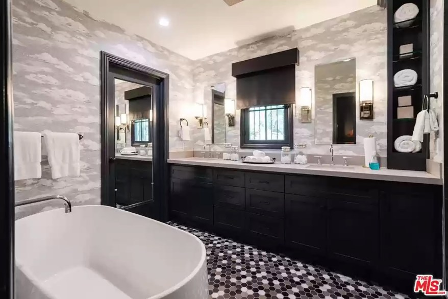 A bathroom with dual vanities is pictured.