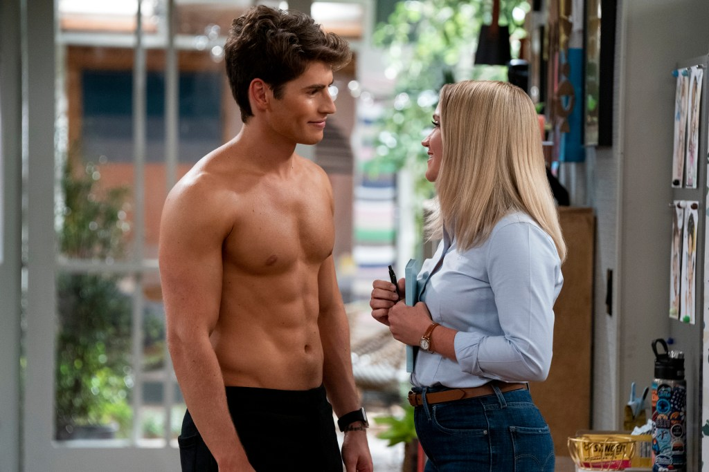 """Gregg Sulkin, shirtless, faces Emily Osment, looking at him and smiling, in """"Pretty Smart."""""""