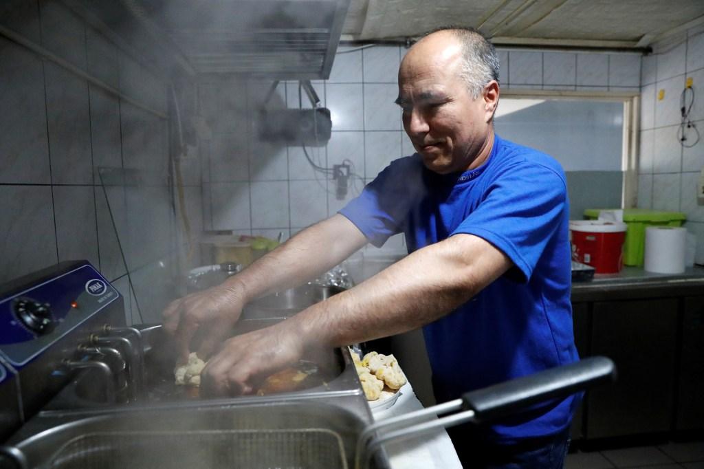 Afghan refugee Murad Sharifi works in a fast food restaurant in Budapest, Hungary, September 27, 2021.