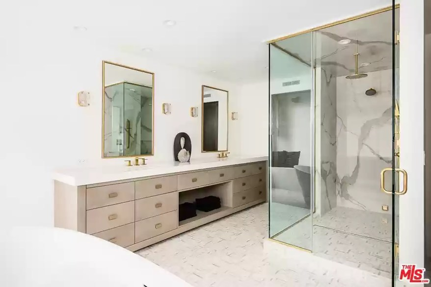 A bathroom with a large walk-in shower is pictured.