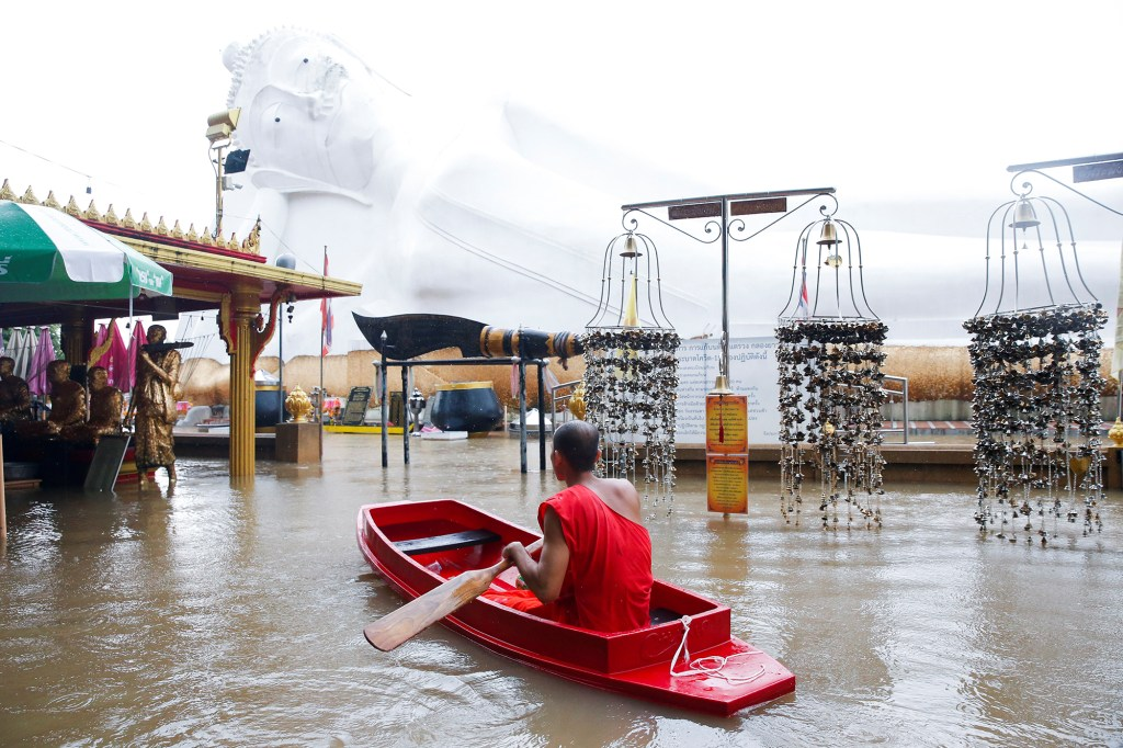A lying Buddha statue is seen during the flood at a Temple in Ayutthaya, Thailand, October 6, 2021.
