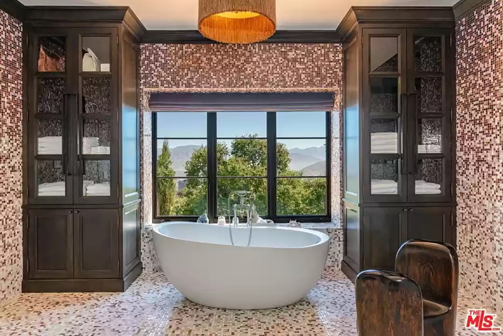 A colorful, tiled bathroom is pictured.