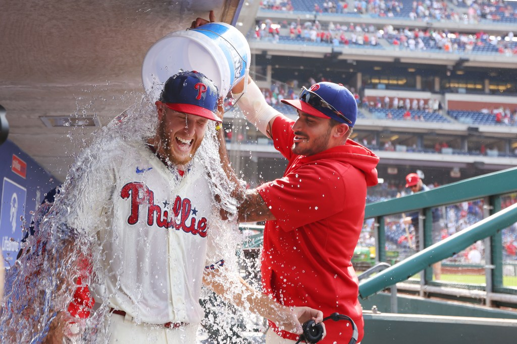 Zack Wheeler doused with water after pitching a two-hit complete game shutout.