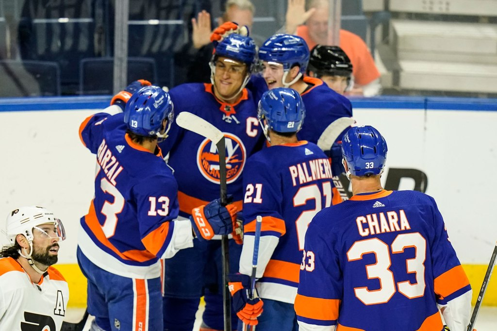 New York Islanders' Anders Lee celebrates with teammates after scoring a goal