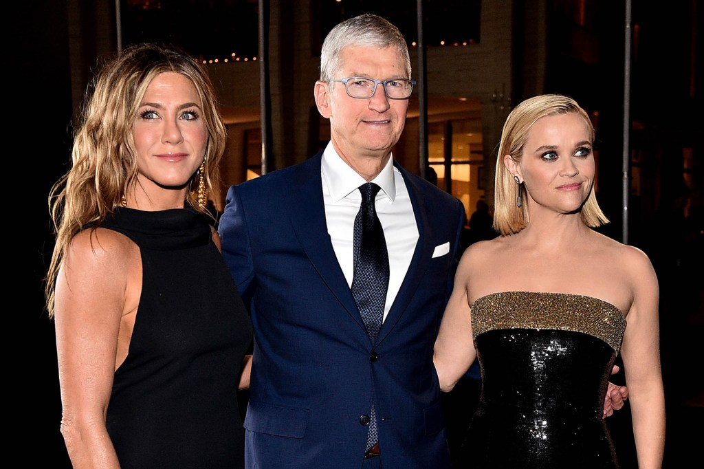 """Apple CEO Tim Cook with Jennifer Anniston and Reese Witherspoon, stars of the company's hit series """"The Morning Show."""""""