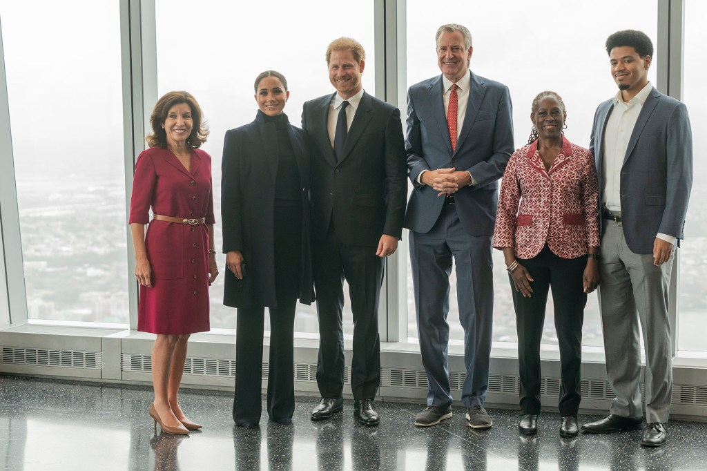 Bill de Blasio, his wife Chirlane McCray and son Dante are pictured with Prince Harry, Meghan Markle Gov. Kathy Hochul on the 102nd floor of the World Trade Center.