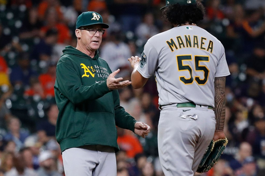 Manager Bob Melvin #6 of the Oakland Athletics takes the ball from Sean Manaea