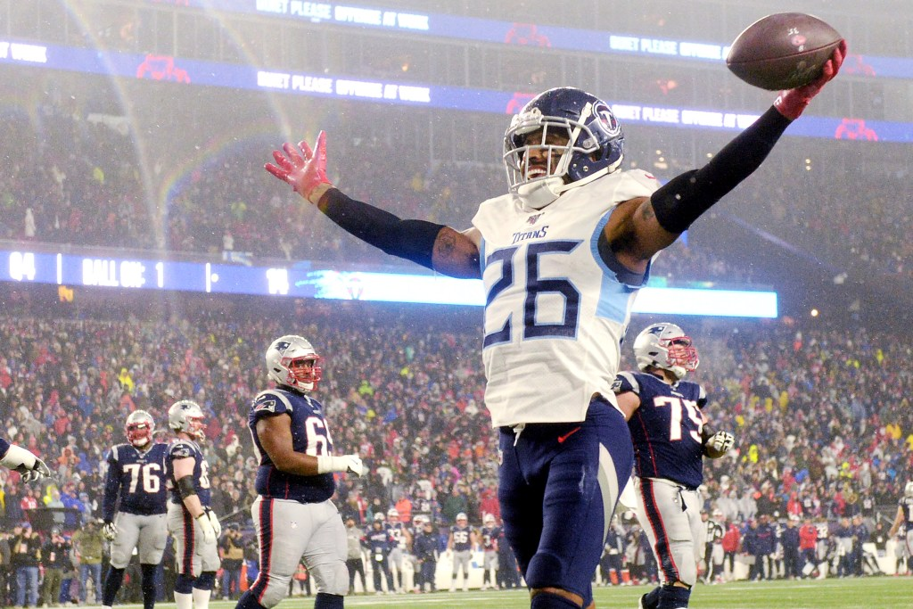 Logan Ryan celebrates an interception against Tom Brady and the Patriots in a 2020 wild-card game.
