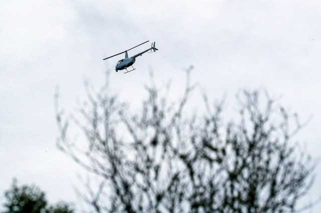 A helicopter aids crews with the FBI and North Port Police and Sheriff's Department.