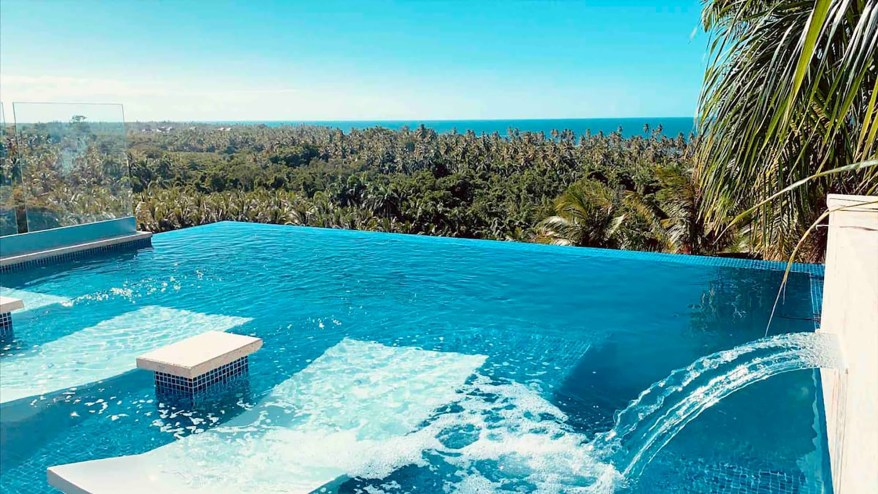 The infinity pool has fountain water features.