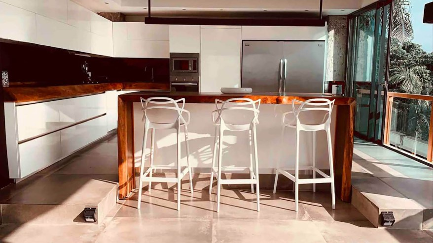 The kitchen has a double fridge, an oven, microwave, hood, five burner gas stove, Hansgrohe taps and a wine fridge, according to the listing.