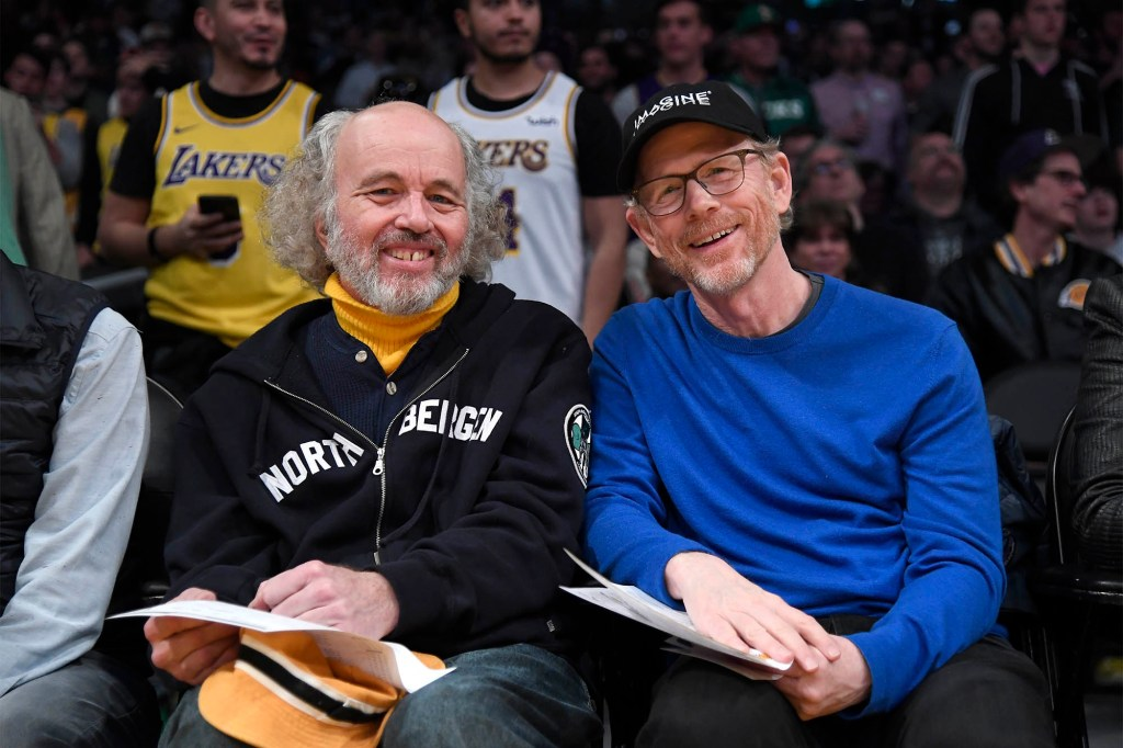 Recent photo showing Ron and Clint Howard sitting next to each other and smiling.