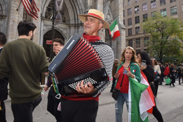 A man named Solo Di Gondoliere from Long Island plays the accordion at the Columbus Day Parade.