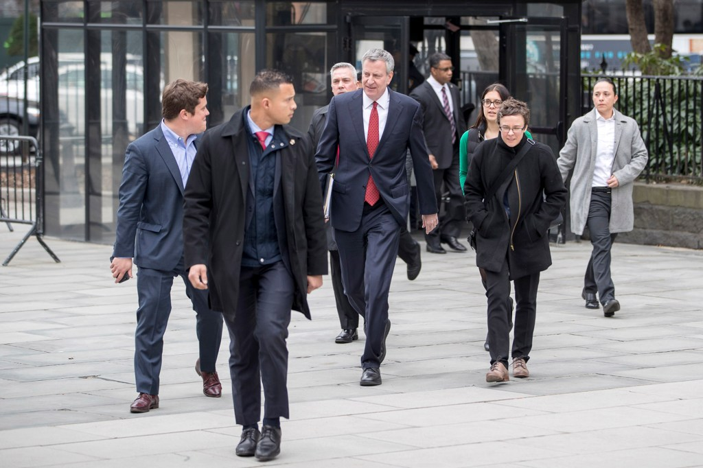 Redmond is seen with de Blasio as the mayor arrives at City Hall.