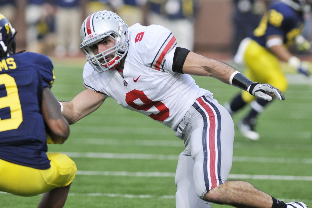 Nate Ebner of Ohio State covers a kick during a game against Michigan.
