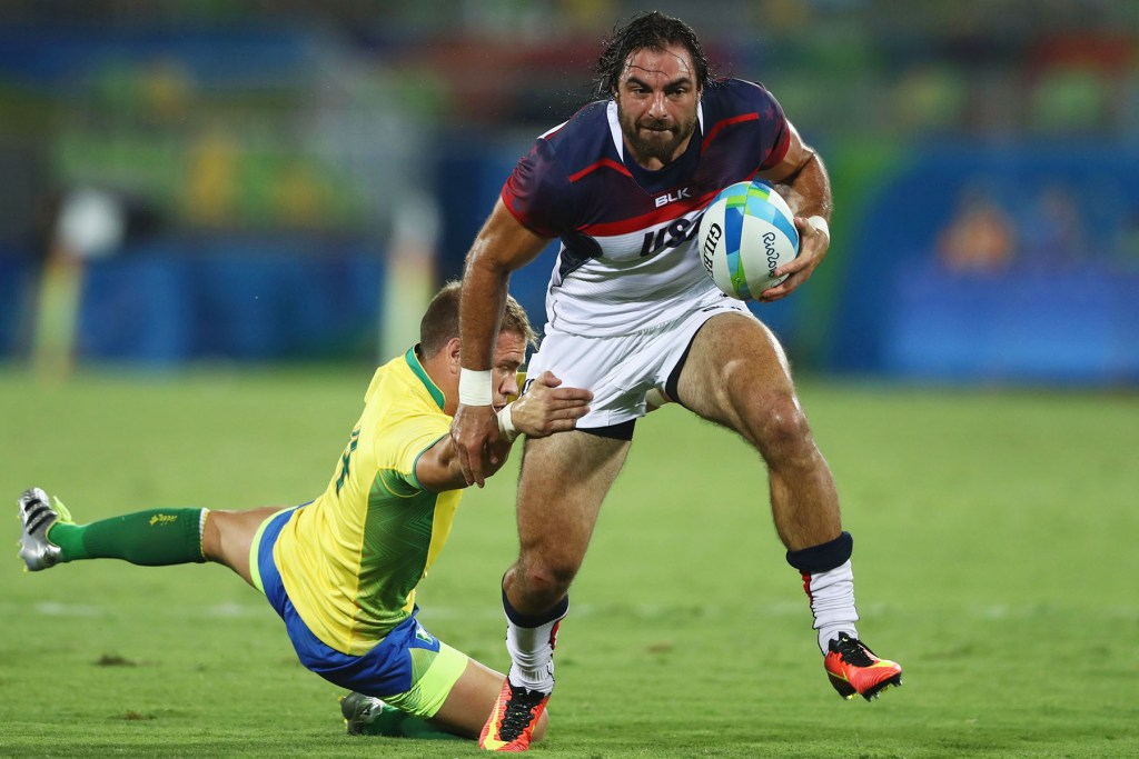 Nate Ebner of the United States breaks a tackle and tries to score during a Men's Rugby Sevens Pool A match against Brazil at the Rio 2016 Olympic Games.